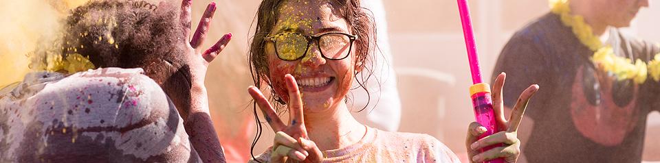 Student at colorful Holi celebration