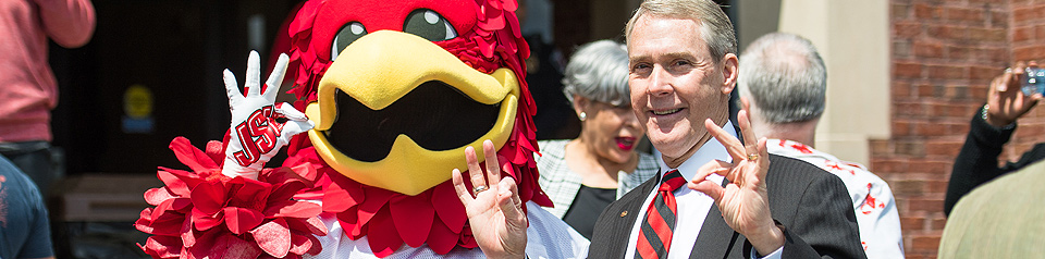 President Beehler and Cocky show their Fear the Beak signs